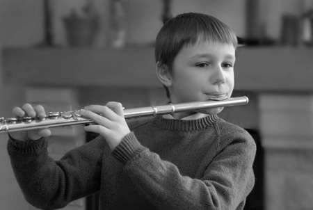 boy playing the flute photo