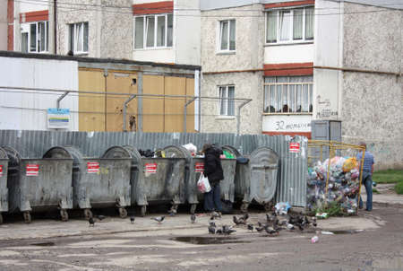 untidily: Ivano-Frankivsk, Ukraine - September 21, 2014:The person searches for something in garbage.