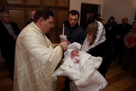 baptizing: LVIV, UKRAINE - 8 February, 2015:Baptism of a child in the Catholic Church Editorial