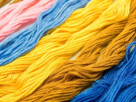 An isolated photo of several colourful threads