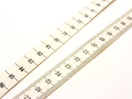 millimetres: plastic measuring ribbon for tailors with inflicted in centimetres and millimetres Stock Photo