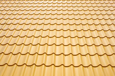 a roof is covered a yellow wavy metal, background
