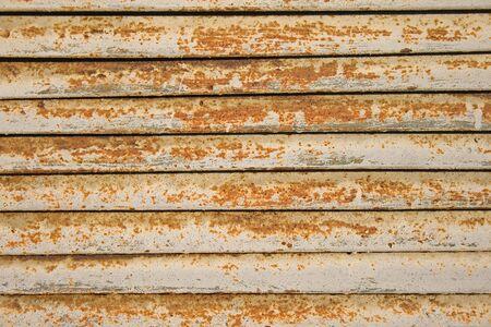 ferruginous: old ferruginous metallic surface with a peeling off paint Stock Photo
