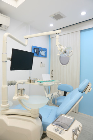 Dentist office is designed of blue color photo