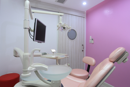 Dentist office is designed of pink color photo