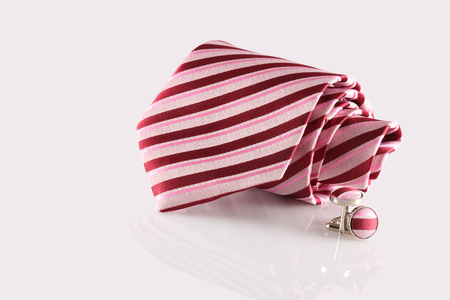 red tie with cuff links on white background