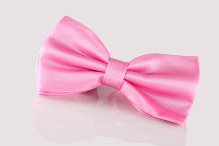 cuff link: pink bow tie close up