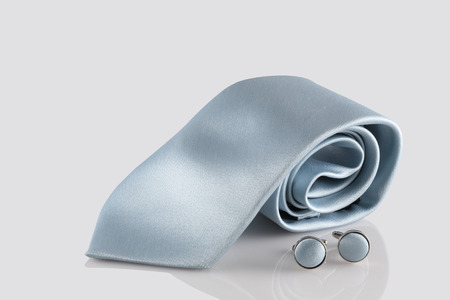 cuff: blue tie with cuff links on white background Stock Photo