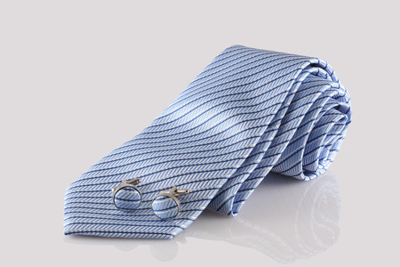 cuff links: blue tie with cuff links on white background Stock Photo