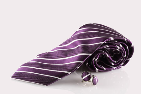 purple tie with cuff links on white background