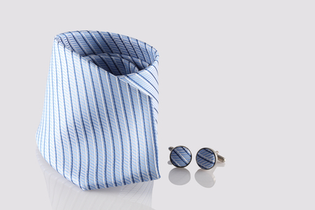 blue tie with cuff links on white background Stock Photo