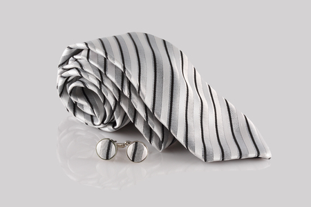 cuff links: tie with cuff links on white background