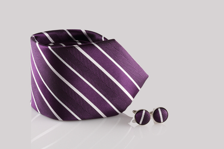 cuff: purple tie with cuff links on white background