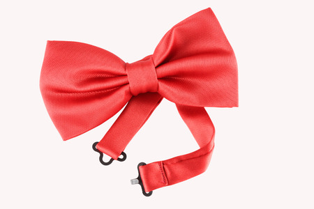 red bow tie close up on white background