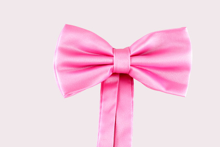 pink bow tie close up on white background