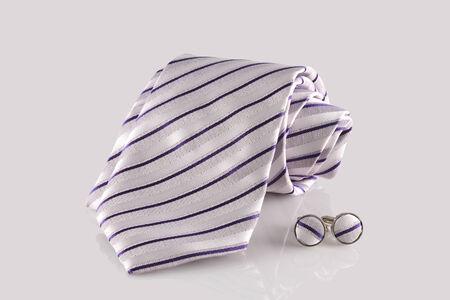 cuffs: tie with cuff links on white background