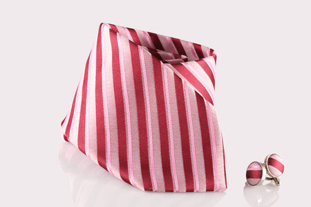cuff links: red tie with cuff links on white background