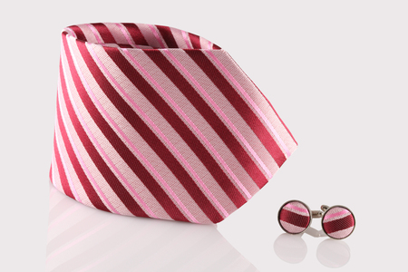 cuff: red tie with cuff links on white background