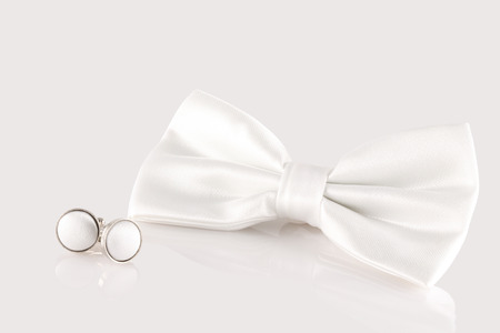 cuff links: white bow tie with cuff links