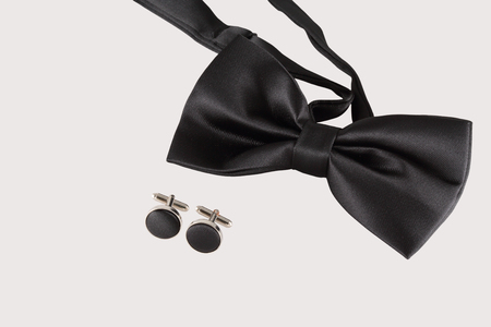 cuff links: black tie with cuff links on white background Stock Photo