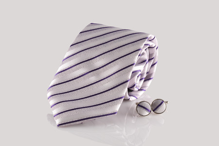 cuff link: tie with cuff links on white background