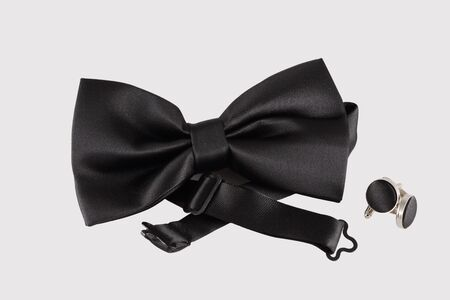 cuff links: black bow tie  with cuff links on white background