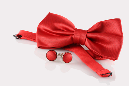 red bow tie  with cuff links on white background photo