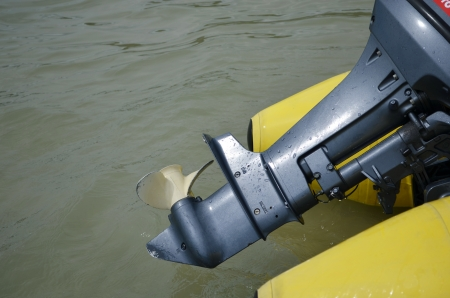 This boat propeller and engine  photo