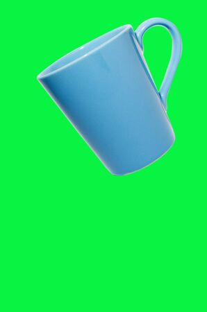 Coffee on blue-green background.