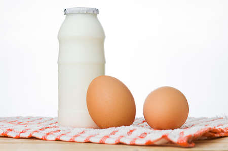 Milk and eggs on a white background