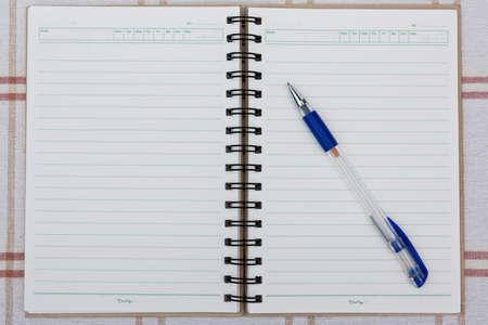 a pen on a spiral notebook. Stock Photo - 11787784