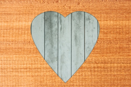 Heart-shaped wooden frame. photo