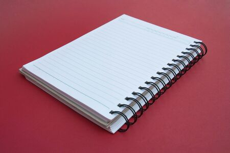 spiral notebook on red background. Stock Photo - 12324753