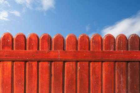 A fence and blue sky. photo