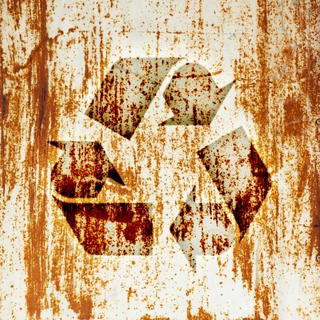 Recycling symbol on the metal surface rust Stock Photo - 13727606