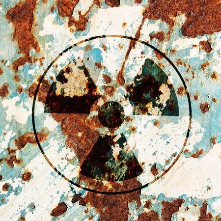 radioactivity warning symbol on metal surface rust  photo