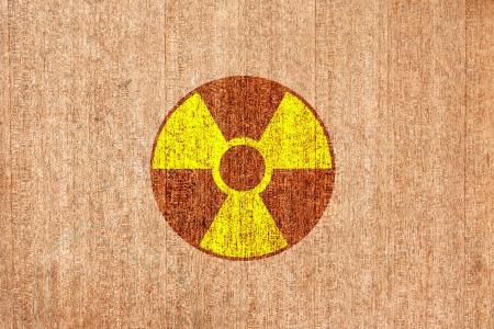 radioactivity warning symbol on wood background Stock Photo - 14078482