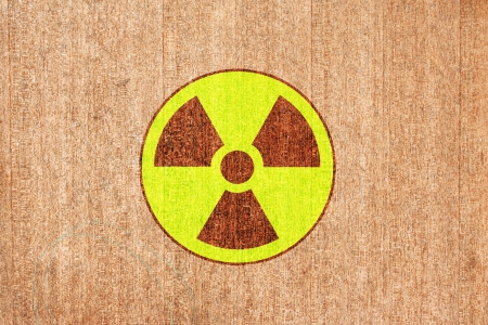 radioactivity warning symbol on wood background Stock Photo - 14078479