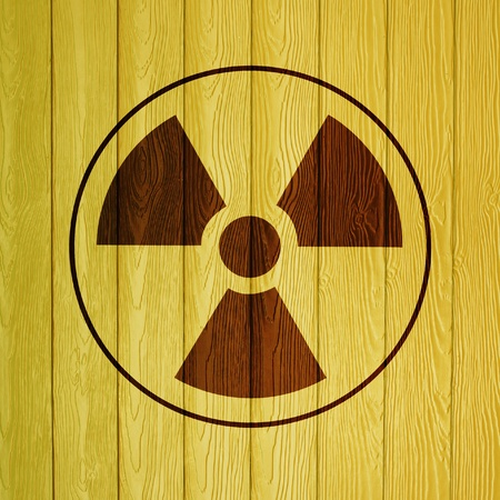 radioactivity warning symbol on wood background Stock Photo - 14078457