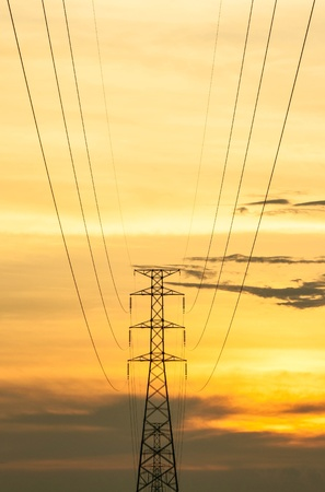 High voltage transmission tower during sun set photo