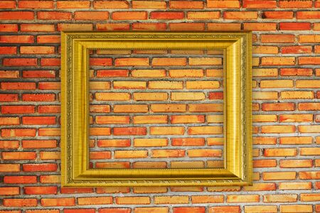 Golden Frame on old brick wall Stock Photo - 14657692