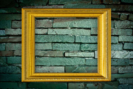 Golden Frame on old brick wall Stock Photo - 14657698