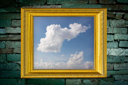 cloud picture and golden frame on old brick wall Stock Photo - 14657686