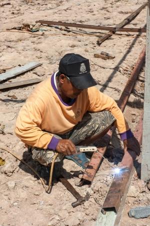 nakhon: Sakon Nakhon, Thailand - September 19  Worker welding steel Burma on September 16, 2011 in Sakon Nakhon, Thailand