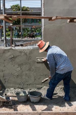 Sakon Nakhon, Thailand - September 19  Plasterer Myanmar plastering in construction work on September 16, 2011 in Sakon Nakhon, Thailand  Editorial
