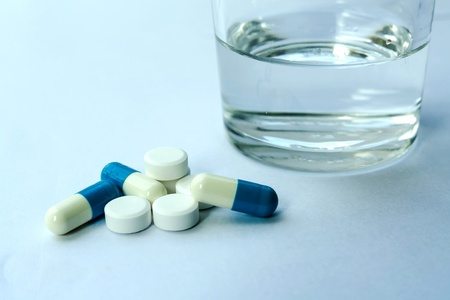 Glass of water and pills Stock Photo