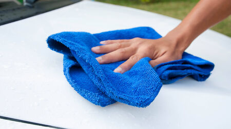 cleaning car using microfiber cloth photo
