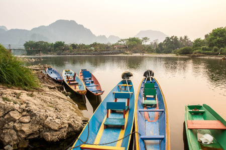 River in Laos Vang Vieng Landscape Boat park at riverside  photo