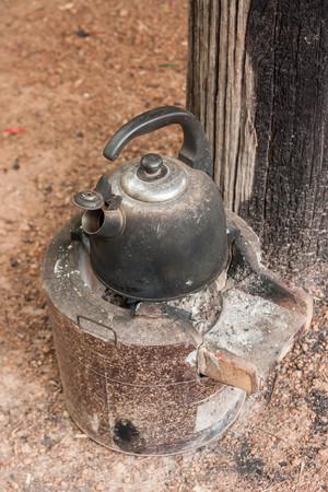Old teapot boils on campfires