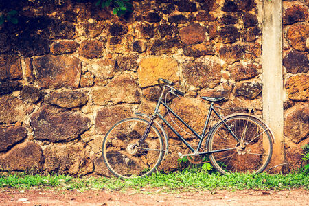 Old retro bicycle and brick wall photo